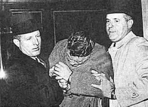 Джон Бутенко в сопровождении агентов ФБР