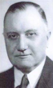 Хью Синклер, который одновременно являлся ещё и директором SIS